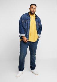 Levi's® Plus - 502™ REGULAR TAPER - Straight leg jeans - adriatic adapt - 1
