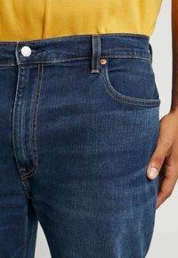 Levi's® Plus - 502™ REGULAR TAPER - Straight leg jeans - adriatic adapt - 3