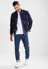 Levi's® Line 8 - LINE 8 512 SLIM TAPER - Slim fit jeans - fences - 1