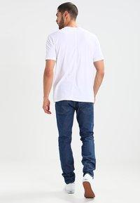 Levi's® Line 8 - LINE 8 512 SLIM TAPER - Slim fit jeans - fences - 2