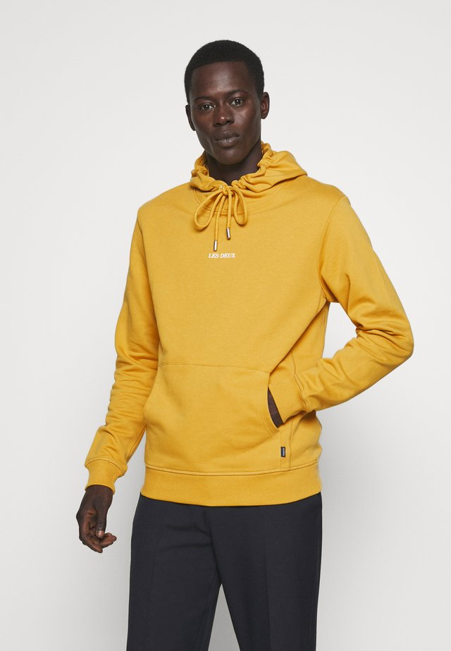 LENS HOODIE - Jersey con capucha - yellow / white