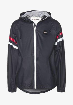 RAIN JACKET - Waterproof jacket - navy