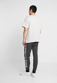 Levi's® Engineered Jeans - LEJ ANNIVERSARY - Pantalon de survêtement - black - 2