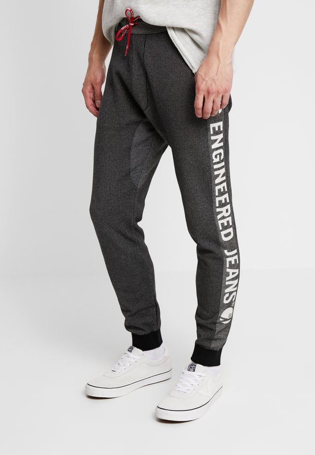 LEJ ANNIVERSARY - Teplákové kalhoty - black