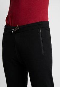 Levi's® Engineered Jeans - LEJ TAPER JOGGERS - Trainingsbroek - black - 3