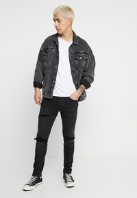 Levi's® Engineered Jeans - LEJ 512 SLIM TAPER - Slim fit jeans - black denim - 1