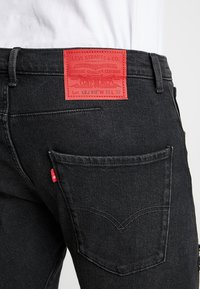 Levi's® Engineered Jeans - LEJ 512 SLIM TAPER - Slim fit jeans - black denim - 5
