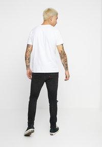 Levi's® Engineered Jeans - LEJ 512 SLIM TAPER - Slim fit jeans - black denim - 2
