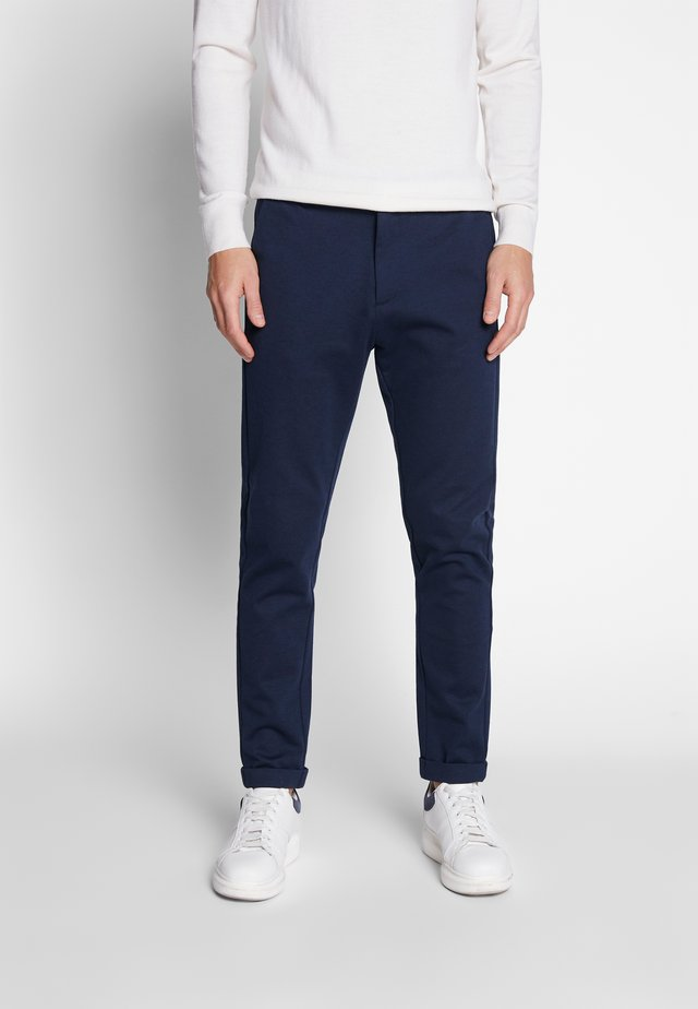 KNITTED CROPPED PANTS - Chinos - navy mix