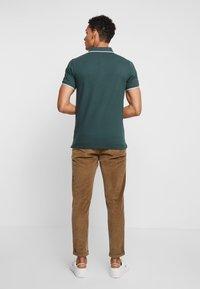 Lindbergh - Poloshirt - moss green - 2