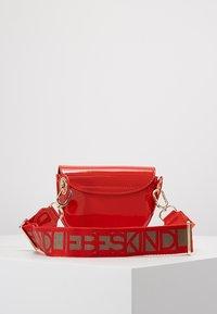 Liebeskind Berlin - VENUS - Bum bag - red patent - 2