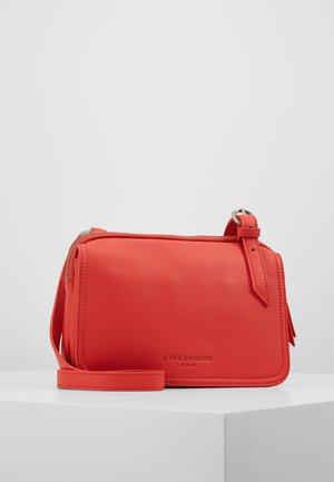 MAREIK - Across body bag - poppy red