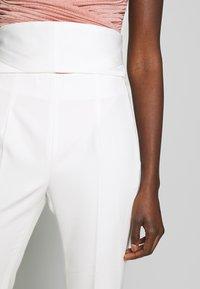 LIU JO - BOOTCUT HIGHT WAIST - Trousers - light white milk - 5