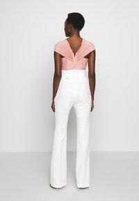 LIU JO - BOOTCUT HIGHT WAIST - Trousers - light white milk - 2
