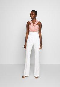 LIU JO - BOOTCUT HIGHT WAIST - Trousers - light white milk - 1