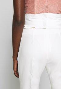 LIU JO - BOOTCUT HIGHT WAIST - Trousers - light white milk - 7