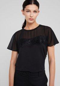 LIU JO - Print T-shirt - nero - 3