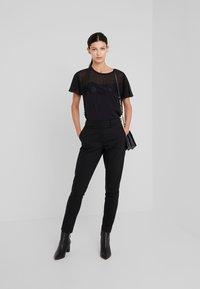 LIU JO - Print T-shirt - nero - 1