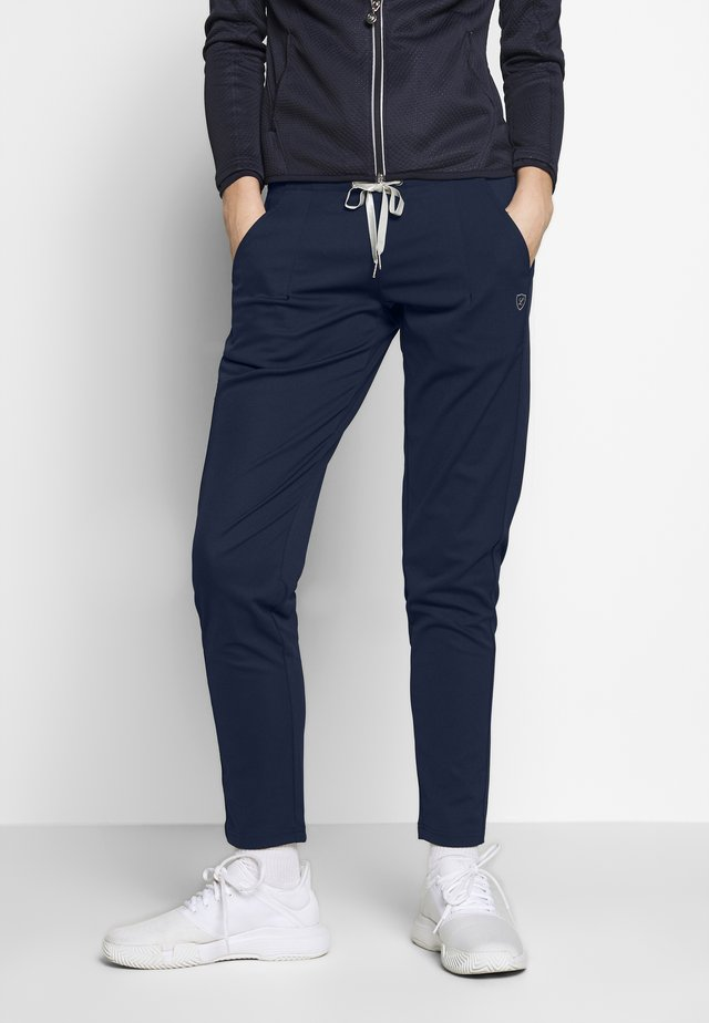 CANDICE - Tracksuit bottoms - eclipse blue