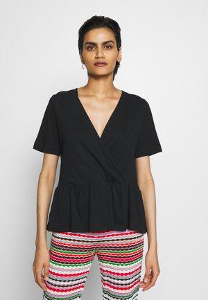 GRACE - T-shirt med print - black