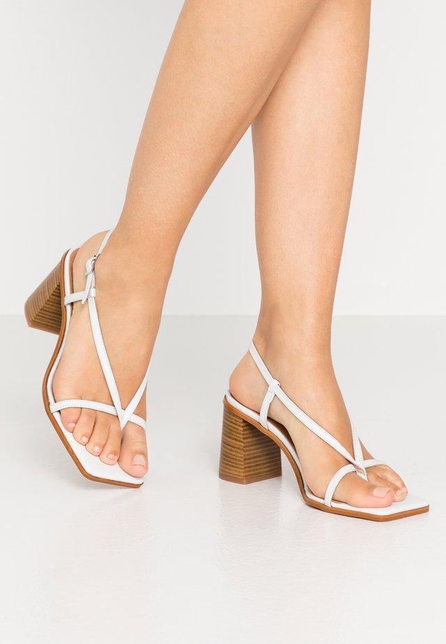 PASION - T-bar sandals - blanco star