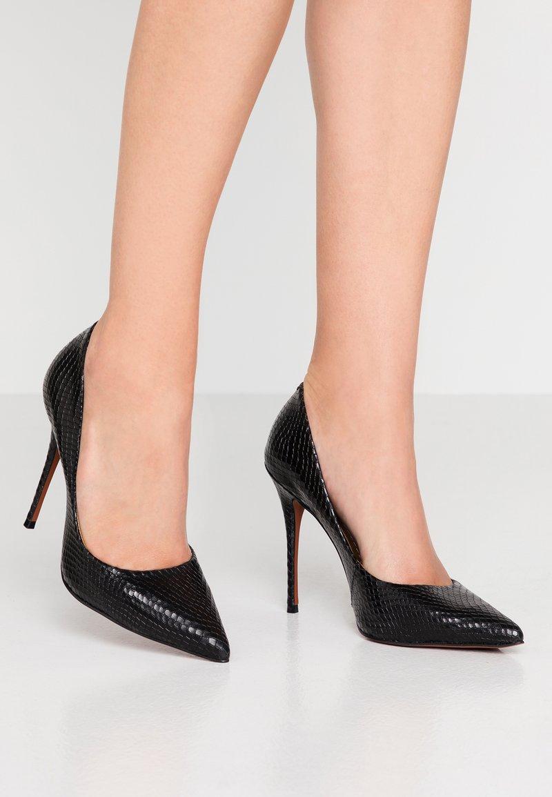 L'INTERVALLE - TEEVA - High heels - black