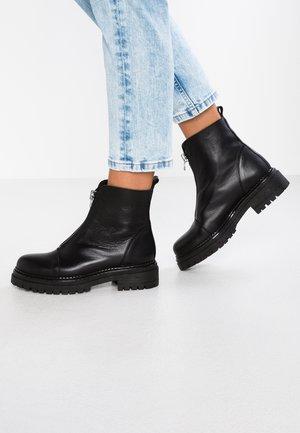 ROHAN - Platform ankle boots - black