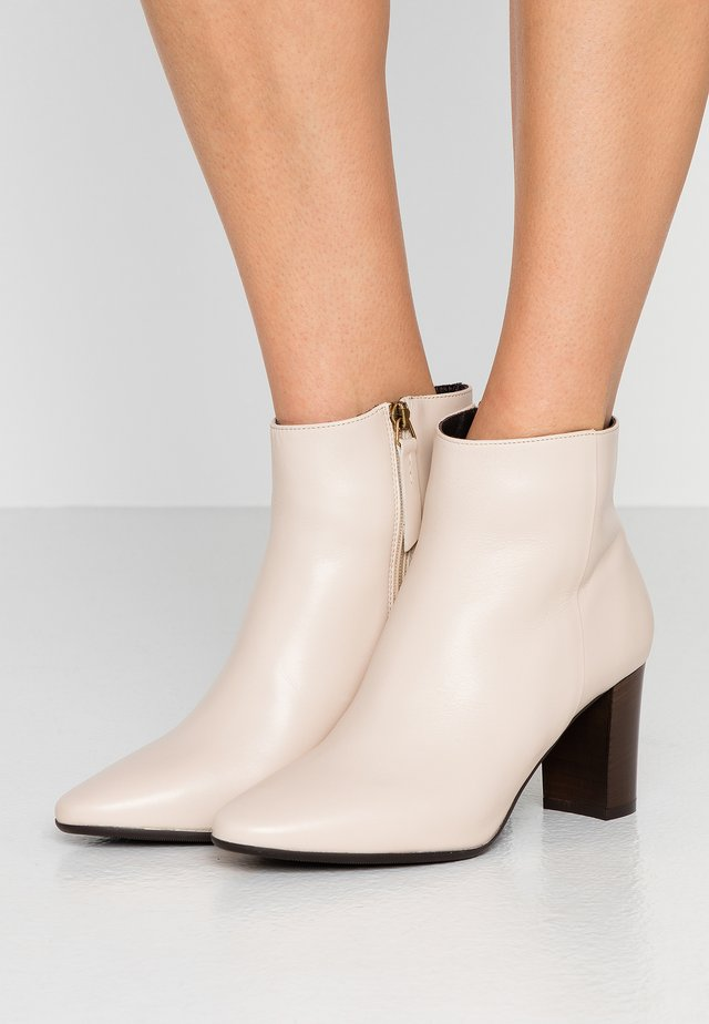 SIRA - Ankle boots - white