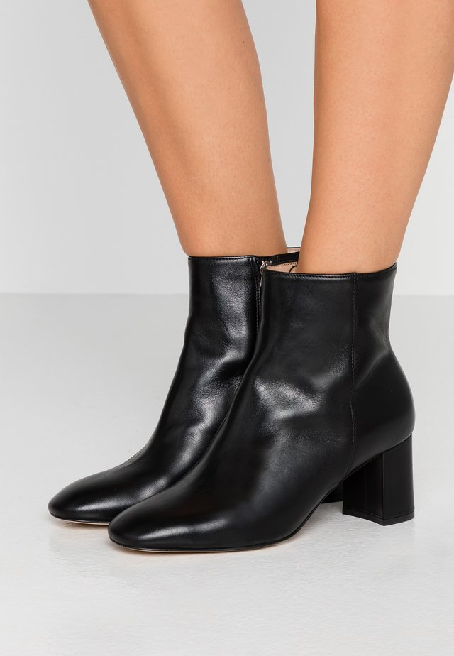 JETTE - Classic ankle boots - black