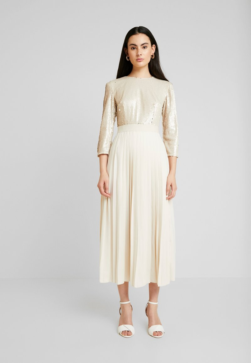 Little Mistress - SEQUIN PLEATED HEM - Juhlamekko - cream