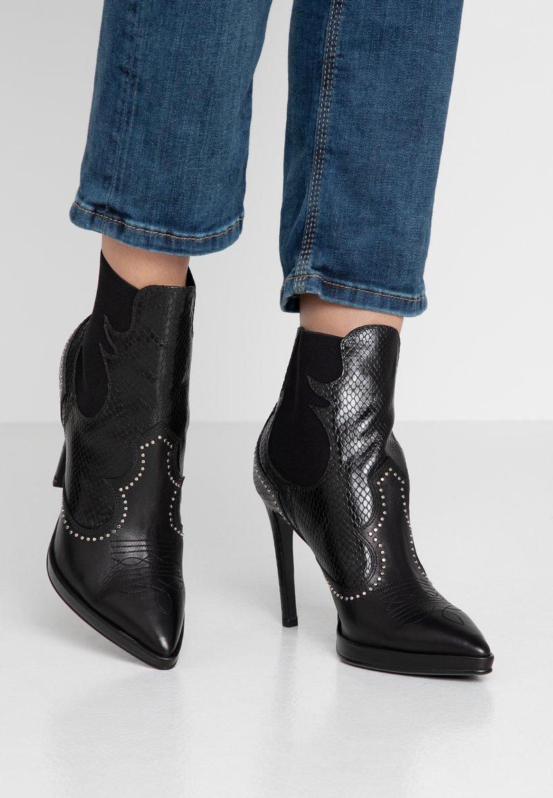 Lola Cruz - High heeled ankle boots - black