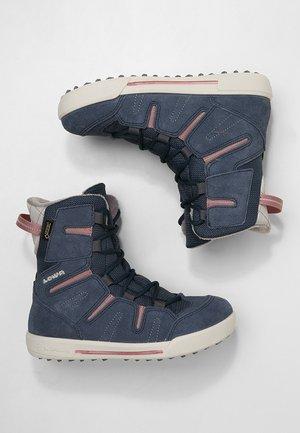 Botas para la nieve - jeans