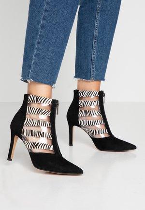 RUSH - Kotníková obuv na vysokém podpatku - nero