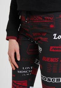 Love Moschino - TROUSERS - Träningsbyxor - black - 4