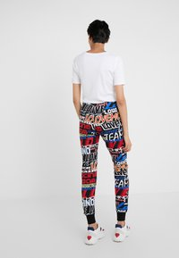 Love Moschino - Tracksuit bottoms - black - 2
