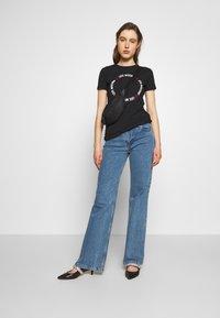 Love Moschino - Print T-shirt - black - 1