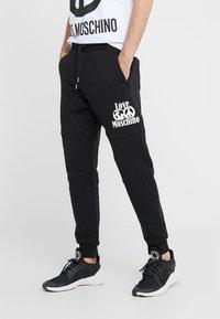 Love Moschino - Pantalones deportivos - black - 0