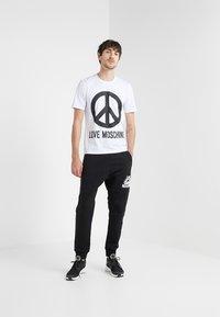 Love Moschino - Pantalones deportivos - black - 1