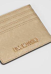 Love Moschino - Etui na wizytówki - gold - 2
