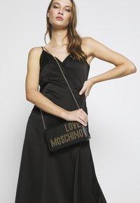 Love Moschino - Across body bag - black/gold - 1