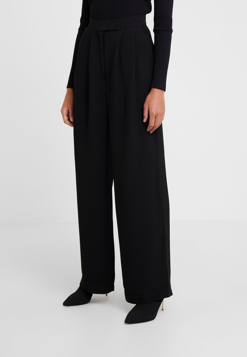 Lovechild - LULAS - Trousers - black