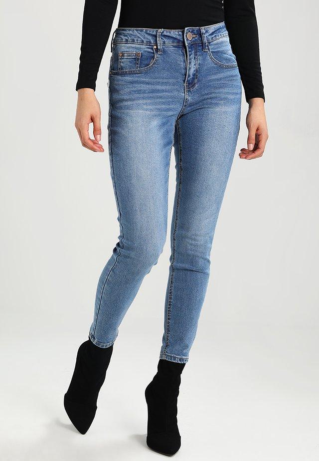 MID RISE IN JANUS - Jeans Skinny Fit - mid denim