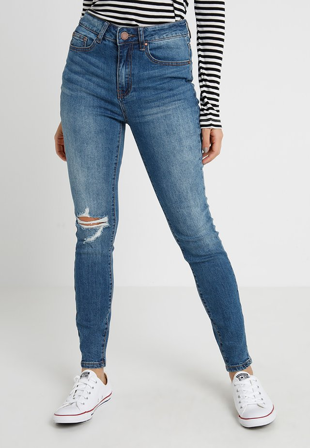 EXCLUSIVE HIGH RISE IN SPACE 1 KNEE RIP - Jeans Skinny Fit - mid denim
