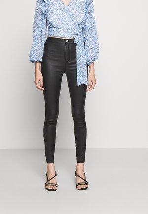 Skinny džíny - coated black