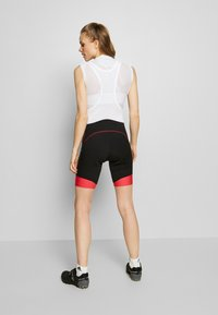 LÖFFLER - BIKE BIB SHORTS EVO - Leggings - black/flamenco