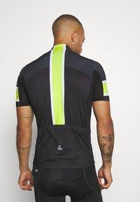 LÖFFLER - BIKE PACE - T-Shirt print - black/light green - 2