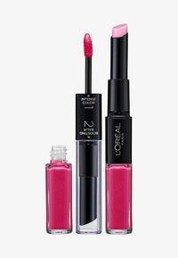 L'Oréal Paris - INFAILLIBLE X3 LIPSTICK - Lippenstift - 121 flawless fuschia - 0
