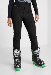 Luhta - JOENTAKA - Ski- & snowboardbukser - black - 0