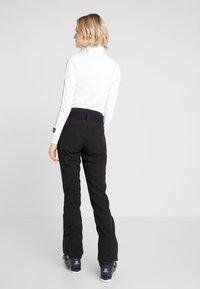 Luhta - JOENTAUS - Pantalon de ski - black - 2