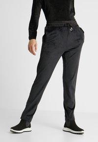 Luhta - ENANNIEMI - Pantaloni sportivi - black - 0